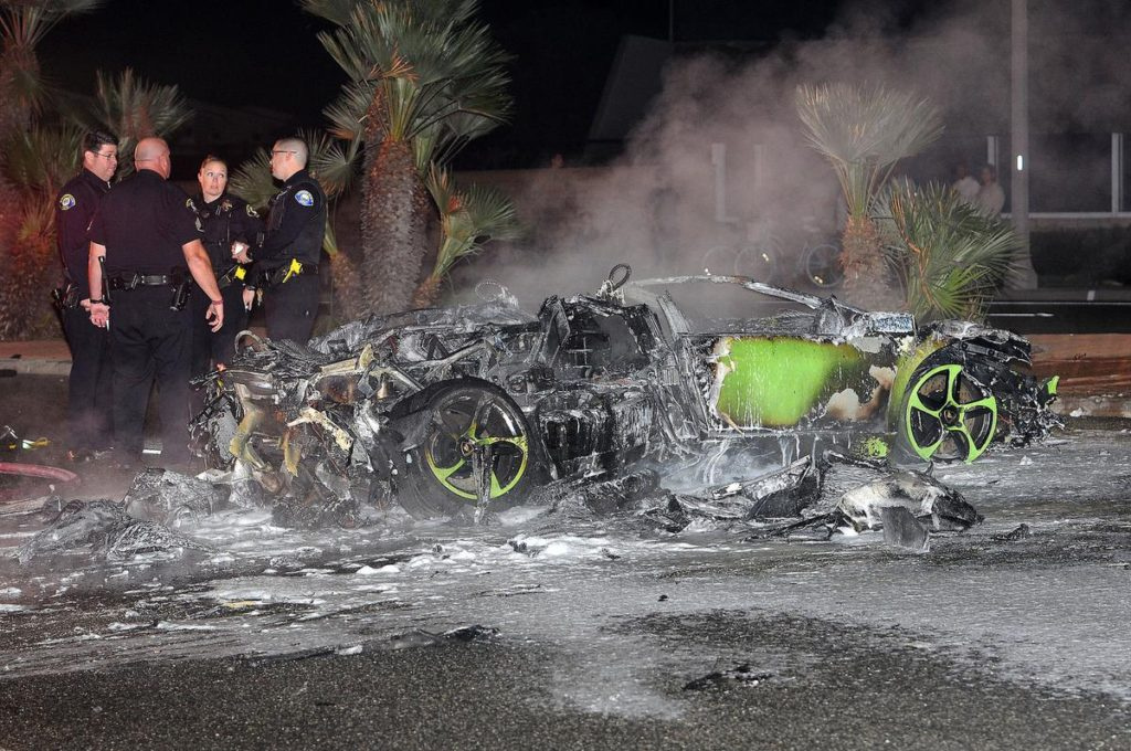 Newport Beach police officers investigate after a Lamborghini crashed and caught fire on the westbound West Coast Highway just east of Prospect Street about 10:40 p.m. Tuesday evening, Octobr 18, 2016. (Richard Koehler, Contributing Photographer)